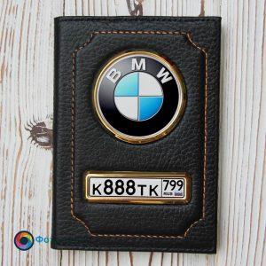 Черная обложка с номером машины